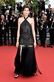 Laetitia Casta worked a hippie-glam vibe at the Cannes closing ceremony in a black Givenchy Couture halter gown that featured an eclectic combination of fringes, lace, and tassels.