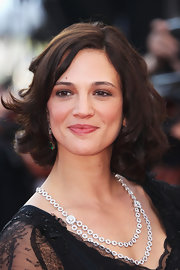 Asia Argento flaunted her medium length curls while walking the red carpet at the Cannes Film Festival.