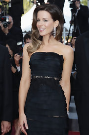 Kate looked stunning in her Nina Ricci gown. She paired her strapless dress with dangling diamond earrings.