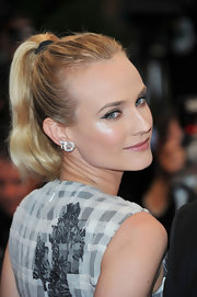 Diane Kruger arrived for the closing ceremony of the Cannes Film Festival wearing her hair in a simple sleek ponytail.