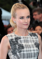 Diane Kruger swept on winged black liner and a touch of soft neutral shadow for subtle definition.