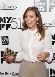 An embellished gold and black box clutch added major elegance to Olivia Wilde's simple outfit at the gala presentation of 'Her.'