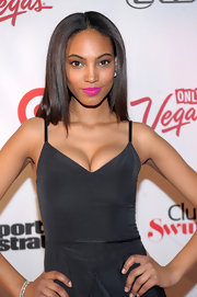 Ariel Meredith may have opted for a little black dress, but the model chose bright pink lips for the Club SI Swimsuit event in Las Vegas.
