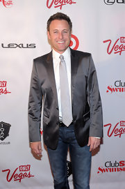 Chris Harrison chose a silver satin blazer to dress up his jeans while attending the Club SI Swimsuit event in Las Vegas.