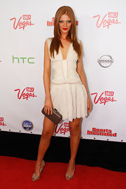 Cintia donned a flouncy white cocktail dress with a deep plunge for the Vegas Swimsuit Illustrated launch.