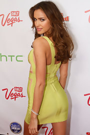 Irina Shayk paired her sexy bandage dress with delicate silver bangle bracelets.