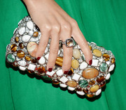 Wendy Nguyen topped off her ensemble with an ultra-glam gemstone-inlaid clutch when she attended the Club Tacori event.