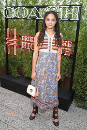 Sasha Lane completed her ensemble with a cute rocket-print purse.