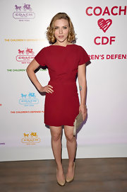 Scarlett Johansson teamed her berry dress with a nude leather Madison clutch.