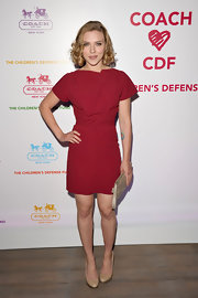 Scarlett Johansson looked sweet chic in a vibrant red Roland Mouret cocktail dress for the Coach sponsored Chidren's Defense Fund benefit in Santa Monica. The blonde bombshell wore her hair in chin-length curls and accessorized appropriately with a Coach clutch and heels.