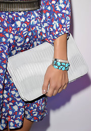 Sophia Bush completed her printed cocktail dress with a turqouise-and-silver bangle stone bracelet.