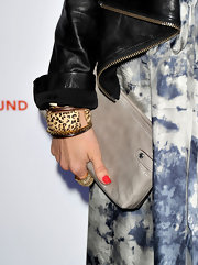 Abigail Spencer took a walk on the wild side with a leopard print bangle bracelet.