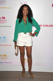 Garcelle Beauvais teamed her sultry shorts with gold metallic T-Strap sandals.