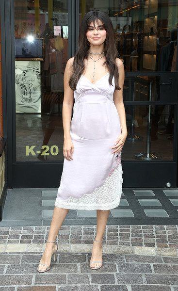 Selena Gomez showed off a pale lilac slip dress from her collection with Coach while attending a meet-and-greet.