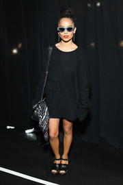 Zoe Kravitz threw on a baggy black patchwork sweater dress for the Coach fashion show.