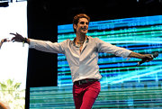 Perry rocked out in a white shirt with vibrant pink pants and a silver studded leather belt.