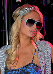 Paris wears modernized aviators with blue rims for the Coachella Music Festival.
