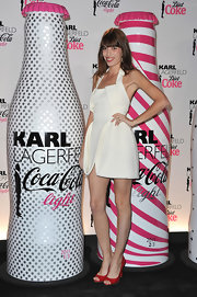 Lou donned a crisp white cocktail dress for the Karl and Coca-Cola collaboration celebration.