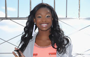Coco Jones unleashed her girly side as she sported romantic loose curls when she visited the Empire State Building.