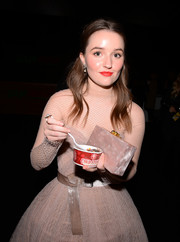 Kaitlyn Dever complemented her beige gown with a pearlescent box clutch by Edie Parker for the 2020 Critics' Choice Awards.
