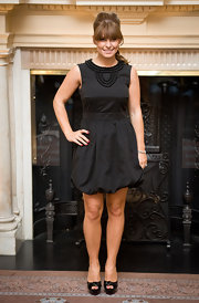 Coleen dons a little black dress with a bubble skirt and a beaded neckline.