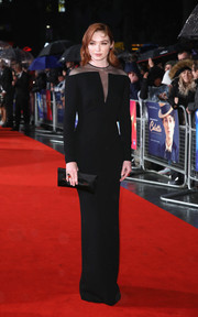 Eleanor Tomlinson matched her dress with a black satin clutch, also by Tom Ford.