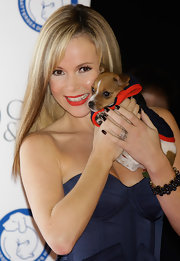 Amanda Holden complemented her look at the Collars & Coats Gala Ball with a thick bracelet of dark blue gemstones.