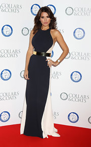 Danielle Bux looked elegant in a navy and white evening dress at the Collars & Coats Gala Ball in London.