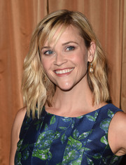 Reese Witherspoon was summer-chic with her beachy waves and wispy bangs at the Colleagues' Spring Luncheon.