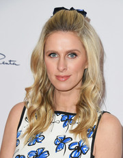 Nicky Hilton looked retro-cute wearing this bouncy half-up hairstyle at the Colleagues and Oscar de la Renta spring luncheon.