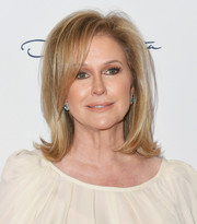 Kathy Hilton attended the Colleagues and Oscar de la Renta spring luncheon wearing her hair in a bouncy flip.