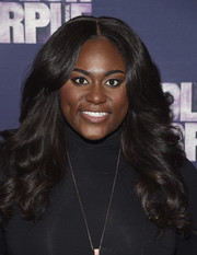 Danielle Brooks channeled the '70s with this feathered flip during the 'Color Purple' Broadway cast photocall.