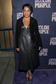 Selenis Leyva layered a black velvet jacket over her dress for added elegance.