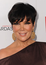 Kris Jenner topped off her bold look with gold dangling earrings. Which were the perfect finish to her radiant short hair cut.