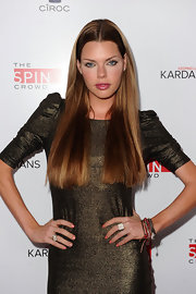 Sophie Monk showed off her long center part locks while walking the red carpet at the Comcast party.