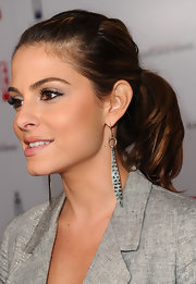 Maria paired her sleek blazer with silver dangling earrings with a classic ponytail.
