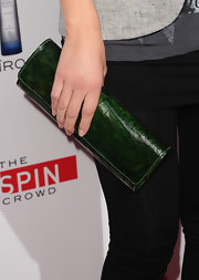Maria paired her sleek look with a green crocodile clutch.