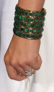 Kendra added high contrast to her white frock with an emerald green bracelet.