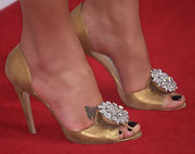 Kimora is known for her fascination with all things sparkling. She donned a pair of peep-toe  pumps, which featured a sparkling embellishment.
