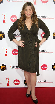 Danielle Fishel went for a subdued yet classy look with a brown wrap dress and basic black pumps at the TCA party.