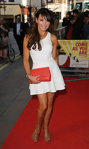 Lizzie Cundy wore this sleeveless white frock with a cinched waist for her look at the 'Come As You Are' premiere.