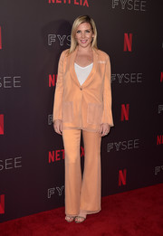 June Diane Raphael opted for a bright peach pantsuit when she attended the Comediennes: In Conversation event.