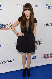 Carly did a sexy take on '80s style in this black mesh LBD.