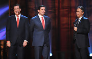 Stephen wears his signature pinstripe suit and red tie on stage for Comedy Central.