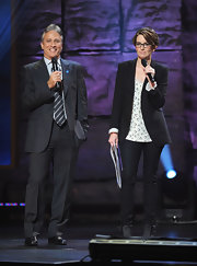 Jon Stewart showed off a sleek suit a striped tie while attending a concert for Autism Education.