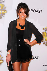 Christina Teigen wore a gold statement neckalce to the Comedy Central  Roast of Donald Trump.