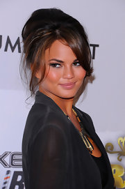 Sexy bombshell Chrissy Teigen opted for a teased chignon to finish off her chic outfit.