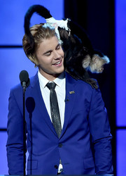 Justin Bieber paired a shiny black tie with a blue suit for the Comedy Central Roast.