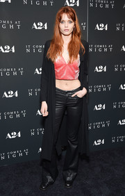 Abbey Lee Kershaw teamed her top with a pair of flared leather pants.