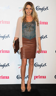 Lydia Rose Bright mixed and matched a sheer beaded blouse, a cardigan, and a leather skirt with fabulous results.